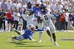 SMU safety Isaiah Nwokobia (12) lunges at TCU running back Zach Evans (6) as he runs for a touchdown during the first half of an NCAA football game in Fort Worth, Texas, Saturday, Sept. 25, 2021. (AP Photo/Michael Ainsworth)