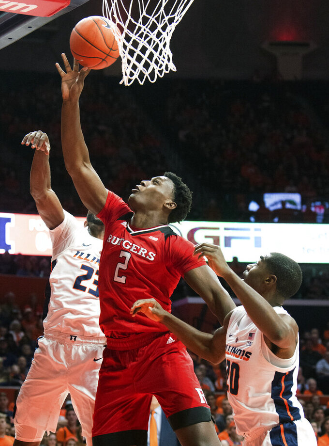 Rutgers center Shaquille Doorson (2) goes against Illinois guards Aaron Jordan (23) and Da'Monte Williams (20) in the first half of an NCAA college basketball game in Champaign, Ill., Saturday, Feb. 9, 2019. (AP Photo/Robin Scholz)