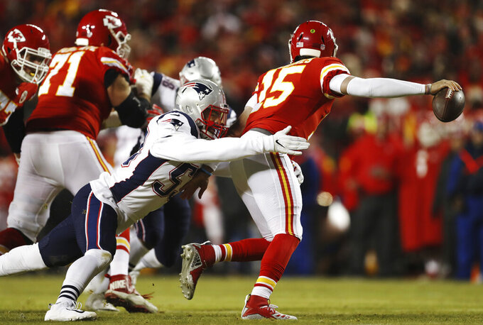 New England Patriots middle linebacker Kyle Van Noy (53) sacks Kansas City Chiefs quarterback Patrick Mahomes (15) during the first half of the AFC Championship NFL football game, Sunday, Jan. 20, 2019, in Kansas City, Mo. (AP Photo/Jeff Roberson)