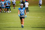 Carolina Panthers running back Christian McCaffrey walks across the practice field during a break at the NFL football team's training camp practice Sunday, Aug. 16, 2020 in Charlotte, N.C. (AP Photo/Nell Redmond)