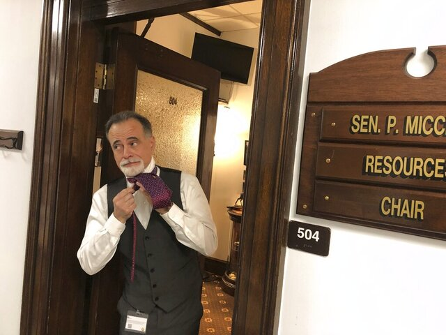 State Sen. Peter Micciche prepares for the Alaska Senate floor session on Tuesday, Jan. 19, 2021, in Juneau, Alaska. Micciche, a Soldotna Republican, was elected Senate president on Tuesday. (AP Photo/Becky Bohrer)