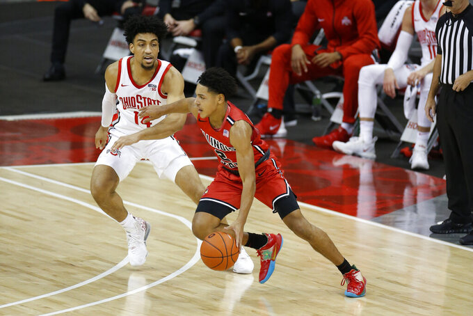 Illinois State's Josiah Strong, right, drives to the basket against Ohio State's Justice Sueing during the first half of an NCAA college basketball game Wednesday, Nov. 25, 2020, in Columbus, Ohio. (AP Photo/Jay LaPrete)