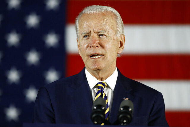 FILE - In this June 17, 2020, file photo, Democratic presidential candidate, former Vice President Joe Biden speaks in Darby, Pa. The coronavirus pandemic isn't going away anytime soon, but campaigns are still forging ahead with in-person organizing. The pandemic upended elections this year, forcing campaigns to shift their organizing activities almost entirely online and compelling both parties to reconfigure their conventions. (AP Photo/Matt Slocum)