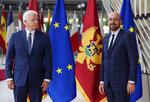 Montenegro's Prime Minister Dusko Markovic, left, and European Council President Charles Michel pose for the media before their meeting at the Europa building in Brussels, Monday, July 13, 2020. (Stephanie Lecocq, Pool Photo via AP)