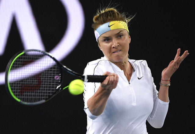 Elina Svitolina of Ukraine makes a forehand return to Lauren Davis of the U.S.during their second round singles match at the Australian Open tennis championship in Melbourne, Australia, Thursday, Jan. 23, 2020. (AP Photo/Andy Brownbill)
