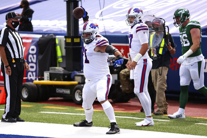 Buffalo Bills offensive tackle Ryan Bates, center, spikes the ball after Josh Allen (17) ran for a touchdown during the first half of an NFL football game against the New York Jets in Orchard Park, N.Y., Sunday, Sept. 13, 2020. (AP Photo/Jeffrey T. Barnes)
