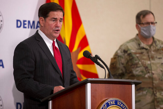 Governor Doug Ducey speaks during a press conference regarding the COVID-19 pandemic at the Arizona National Guard headquarters at Papago Park Military Reservation, on Aug. 20, 2020, in Phoenix. (Sean Logan/The Arizona Republic via AP)