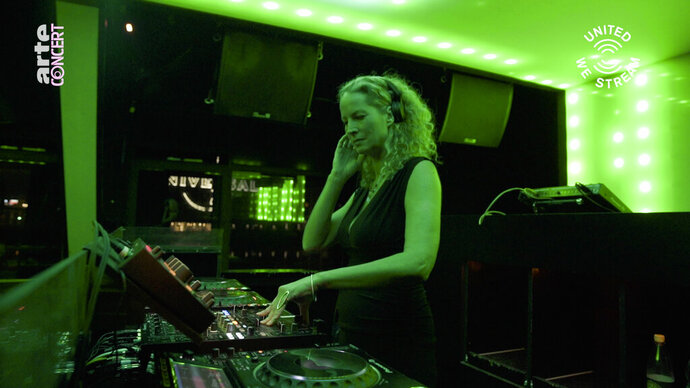 "In this March 18, 2020, frame from video provided by Rundfunk Berlin-Brandenburg, DJ Monika Kruse performs a set as part of the ""United We Stream"" event at the club Watergate in Berlin. Berlin's nightclubs were closed March 13 to help slow the spread of the virus. In response, some of them formed a streaming platform to let DJs, musicians and artists continue performing. (Rundfunk Berlin-Brandenburg via AP)"
