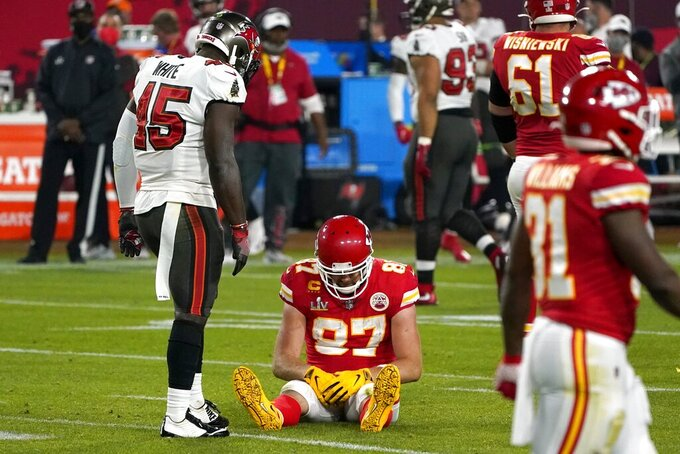 Kansas City Chiefs tight end Travis Kelce (87) sits on the field after an incomplete pass as Tampa Bay Buccaneers inside linebacker Devin White (45) looks on in the second half of the NFL Super Bowl 55 football game, Sunday, Feb. 7, 2021, in Tampa, Fla. (AP Photo/Gregory Bull)
