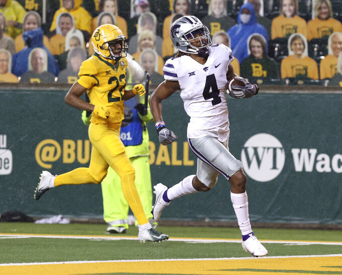 Kansas State wide receiver Malik Knowles (4) scores a touchdown past Baylor safety JT Woods (22) during the first half of an NCAA college football game Saturday, Nov. 28, 2020, in Waco, Texas. (Jerry Larson/Waco Tribune Herald via AP)