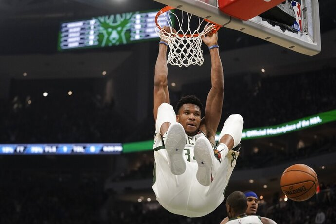 Milwaukee Bucks' Giannis Antetokounmpo dunks during the first half of an NBA basketball game against the Philadelphia 76ers Saturday, Feb. 22, 2020, in Milwaukee. (AP Photo/Morry Gash)