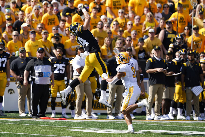 Iowa tight end Sam LaPorta (84) catches a pass over Kent State safety Dean Clark (3) during the first half of an NCAA college football game, Saturday, Sept. 18, 2021, in Iowa City, Iowa. Iowa won 30-7. (AP Photo/Charlie Neibergall)