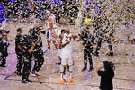 The Los Angeles Lakers players celebrate after the Lakers defeated the Miami Heat 106-93 in Game 6 of basketball's NBA Finals Sunday, Oct. 11, 2020, in Lake Buena Vista, Fla. (AP Photo/Mark J. Terrill)
