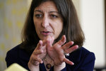 Rep. Elaine Luria, D-Va., gestures during an interview at Naval Station Norfolk Thursday July 15, 2021, in Norfolk, Va. Republicans and Democrats have something in common when it comes to recruiting candidates they hope will deliver majorities in Congress after the 2022 election, and that's military veterans.(AP Photo/Steve Helber)