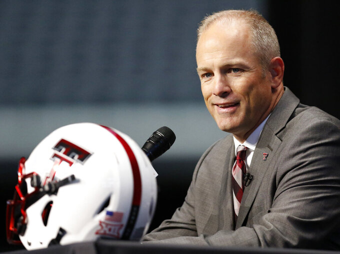 FILE - In this July 15, 2019, photo, Texas Tech head coach Matt Wells speaks on the first day of the Big 12 Conference NCAA college football media days in Arlington, Texas. New Kansas State coach Chris Klieman has seven championship rings, all at the FCS level. Texas Tech's Matt Wells is coming off a successful stretch at his alma mater in the Mountain West Conference. Their Big 12 debuts will be their first games as head coach of a Power Five team.(AP Photo/David Kent, file)