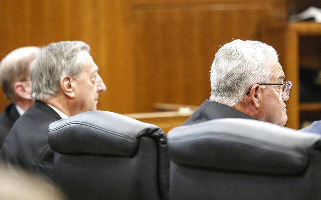 Former University of Wisconsin-Oshkosh administrators Tom Sonnleitner, left, and Richard Wells listen during a court hearing in Winnebago County Circuit Court in Oshkosh, Wis. Wednesday, Jan. 15, 2020. The two former administrators of the University of Wisconsin-Oshkosh pleaded guilty to felony misconduct in connection with a financial scandal involving five building projects. (Doug Raflik/The Fond du Lac Reporter via AP)