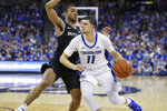 Creighton's Marcus Zegarowski (11) drives past Butler's Aaron Thompson during the second half of an NCAA college basketball game in Omaha, Neb., Sunday, Feb. 23, 2020. (AP Photo/Nati Harnik)