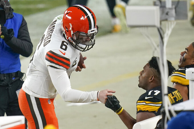 Cleveland Browns quarterback Baker Mayfield (6) greets Pittsburgh Steelers wide receiver JuJu Smith-Schuster (19) after defeating them in an NFL wild-card playoff football game, late Sunday, Jan. 10, 2021, in Pittsburgh. (AP Photo/Keith Srakocic)