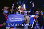Supporters of presidential candidate Rafal Trzaskowski gather in front of Polish Television headquarters before the candidates debate held for the upcoming elections, in Warsaw, Poland, Wednesday, June 17, 2020. (AP Photo/Czarek Sokolowski)