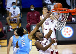 Stanford guard Daejon Davis (1) drives the ball to the basket past North Carolina guard Caleb Love (2) during the second half of an NCAA college basketball game in the semifinals of the Maui Invitational, Tuesday, Dec. 1, 2020, in Asheville, N.C. (AP Photo/Kathy Kmonicek)