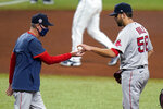 Boston Red Sox pitcher Matt Hall (56) hands the ball to interim manager Ron Roenicke as he is taken out of the game against the Tampa Bay Rays during the fourth inning of a baseball game Friday, Sept. 11, 2020, in St. Petersburg, Fla. (AP Photo/Chris O'Meara)