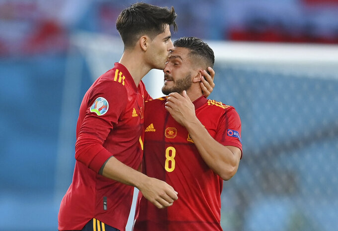 Spain's Alvaro Morata, left, and Koke celebrates after scoring his side's first goal during the Euro 2020 soccer championship group E match between Spain and Poland at La Cartuja stadium in Seville, Spain, Saturday, June 19, 2021. (David Ramos/Pool via AP)
