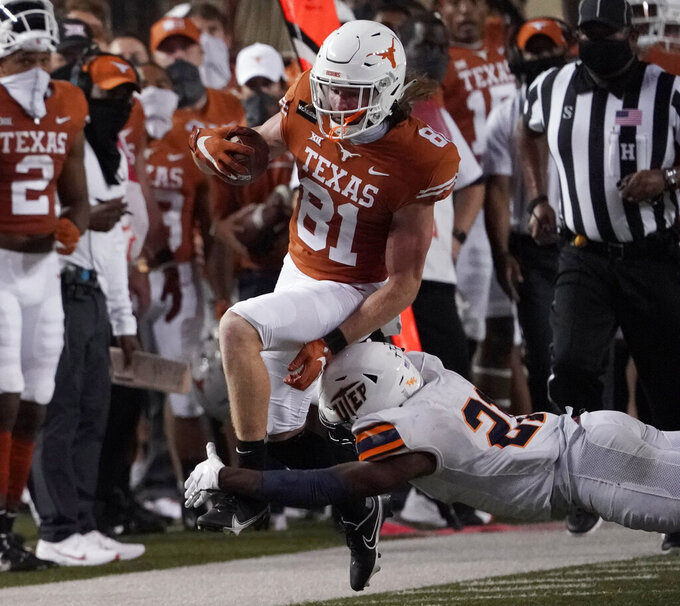 Texas' Brenden Schooler (81) jumps past UTEP's Justin Prince (21) during the first half of an NCAA college football game in Austin, Texas, Saturday, Sept. 12, 2020. (AP Photo/Chuck Burton)