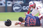 Chicago White Sox second baseman Cesar Hernandez, right, tags out Boston Red Sox's Jose Iglesias (12) at second base during the sixth inning of a baseball game, Sunday, Sept. 12, 2021, in Chicago. (AP Photo/David Banks)