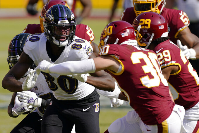Baltimore Ravens wide receiver Miles Boykin (80) runs towards Washington Football Team free safety Troy Apke (30) during the second half of an NFL football game, Sunday, Oct. 4, 2020, in Landover, Md. The Baltimore Ravens won 31-17. (AP Photo/Steve Helber)