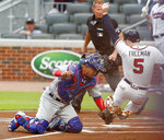 Atlanta Braves first baseman Freddie Freeman (5) is tagged out by Chicago Cubs catcher Willson Contreras (40) in the first inning of a baseball game Tuesday, May 15, 2018, in Atlanta. (AP Photo/John Bazemore)