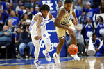 Kentucky's Keion Brooks Jr., left, and Georgia Tech's Moses Wright go after a loose ball during the first half of an NCAA college basketball game in Lexington, Ky., Saturday, Dec. 14, 2019. (AP Photo/James Crisp)