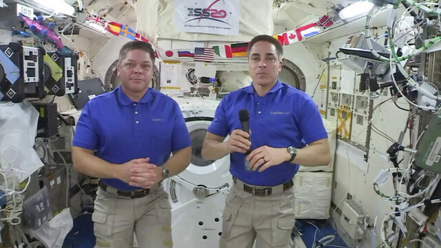 "In this image taken from NASA video, NASA astronaut Chris Cassidy, right answers a question as fellow astronaut Robert L. Behnken listens during an interview aboard the International Space Station, Monday, June 29, 2020. Cassidy, the commander of the International Space Station said Monday that losing a mirror during last week's otherwise successful spacewalk was ""a real bummer.""  Cassidy said he has no idea how the small mirror on his left sleeve came off. The band for the mirror is on pretty tight, he noted, and it may have caught on a metal tether attachment as he exited the airlock Friday.  (NASA via AP)"