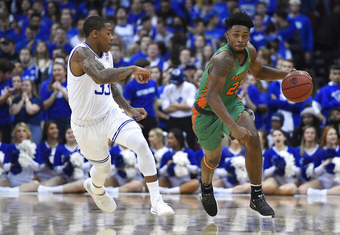 Florida A&M forward Bryce Moragne (23) dribbles the ball against Seton Hall guard Shavar Reynolds (33) during the first half of an NCAA college basketball game, Saturday, Nov. 23, 2019, in Newark, N.J. (AP Photo/Sarah Stier)