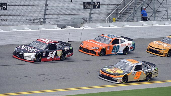 Christopher Bell (54) leads Noah Gragson (9) and Harrison Burton (20) towards turn 1 during the NASCAR Xfinity Series auto race at Daytona International Speedway, Saturday, Aug. 28, 2021, in Daytona Beach, Fla. (AP Photo/Phelan M. Ebenhack)