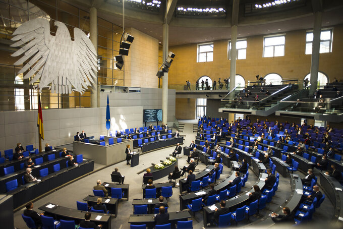 Holocaust survivor Charlotte Knobloch, at the podium center, delivers a speech at the German Federal Parliament, Bundestag, in the Reichstag building in Berlin, Germany, Wednesday, Jan. 27, 2021 during a special meeting commemorating the victims of the Holocaust on the International Holocaust Remembrance Day. (AP Photo/Markus Schreiber)