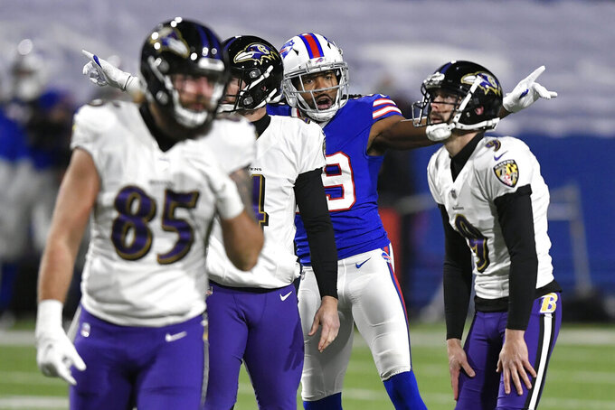 Buffalo Bills' Josh Norman, center, celebrates after Baltimore Ravens kicker Justin Tucker (9) missed a field goal during the first half of an NFL divisional round football game Saturday, Jan. 16, 2021, in Orchard Park, N.Y. (AP Photo/Adrian Kraus)
