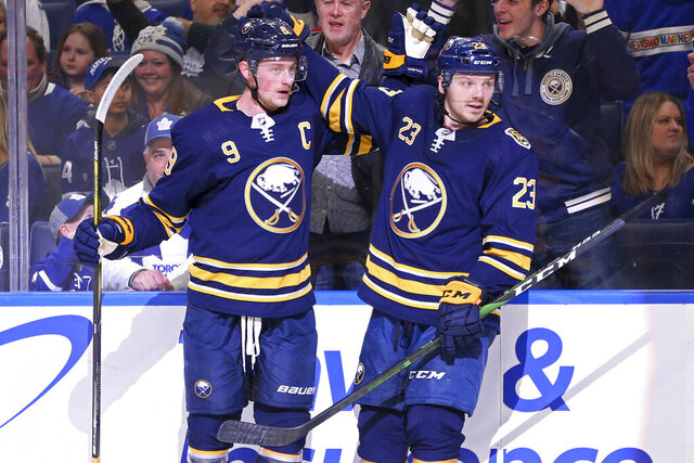 Buffalo Sabres forward Jack Eichel (9) celebrates his goal with forward Sam Reinhart (23) during the third period of the team's NHL hockey game against the Toronto Maple Leafs, Sunday, Feb. 16, 2020, in Buffalo, N.Y. (AP Photo/Jeffrey T. Barnes)