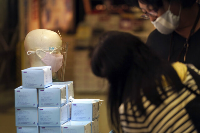 Protective face masks to help curb the spread of the coronavirus are sold at a shop Friday, July 10, 2020, in Tokyo. The Japanese capital has confirmed more than 240 new coronavirus infections on Friday, exceeding its previous record. (AP Photo/Eugene Hoshiko)