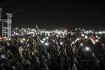 Sudanese protesters use their smartphones' lights during a protest outside the army headquarters in the capital Khartoum on Sunday, April 21, 2019. The organizers of Sudan's protests said Sunday they have suspended talks with the ruling military council because it has failed to meet their demands for an immediate transfer to a civilian government following the overthrow of President Omar al-Bashir. (AP Photo)