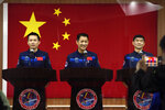 Chinese astronauts, from left, Tang Hongbo, Nie Haisheng, and Liu Boming attend a press conference at the Jiuquan Satellite Launch Center ahead of the Shenzhou-12 launch from Jiuquan in northwestern China, Wednesday, June 16, 2021. China plans on Thursday to launch three astronauts onboard the Shenzhou-12 spaceship, who will be the first crew members to live on China's new orbiting space station Tianhe, or Heavenly Harmony from the Jiuquan Satellite Launch Center in northwest China. (AP Photo/Ng Han Guan)
