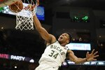 Milwaukee Bucks' Giannis Antetokounmpo dunks during the second half of an NBA basketball game against the Indiana Pacers Sunday, Dec. 22, 2019, in Milwaukee. The Bucks won 117-89. (AP Photo/Morry Gash)