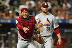 St. Louis Cardinals starting pitcher Jon Lester, right, watches as catcher Yadier Molina throws out New York Mets' Jonathan Villar at first base during the fifth inning of a baseball game Wednesday, Sept. 15, 2021, in New York. (AP Photo/Frank Franklin II)