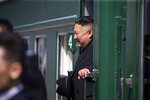 In this photo released by Press office of the administration of Primorsky Krai region, North Korean leader Kim Jong Un looks out from his train as he leaves Russia, at the main train station in Vladivostok, Russia, Friday, April 26, 2019.  North Korean leader Kim Jong Un paid his respects at a ceremony honoring the war dead Friday before wrapping up a brief and generally successful visit to the Russian Far East for his first summit with President Vladimir Putin. (Alexander Safronov/Press Office of the Primorye Territory Administration via AP)