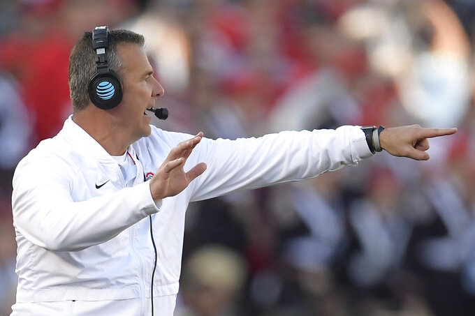 Ohio State coach Urban Meyer yells during the first half of the team's Rose Bowl NCAA college football game against Washington on Tuesday, Jan. 1, 2019, in Pasadena, Calif. (AP Photo/Mark J. Terrill)