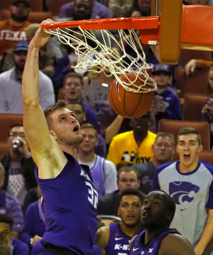 FILE - In this Feb. 12, 2019, file photo, Kansas State forward Dean Wade (32) dunks the ball during the second half of an NCAA college basketball game against Texas, in Austin, Texas. Wade was named to the AP All-Big 12 team, Tuesday, March 12, 2019. (AP Photo/Michael Thomas, File)