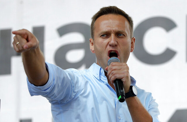 FILE - In this July 20, 2019, file photo, Russian opposition activist Alexei Navalny gestures while speaking to a crowd during a political protest in Moscow, Russia. Berlin's Justice Ministry has approved a request from Moscow for legal assistance in the investigation of the poisoning of opposition leader Alexei Navalny, and has tasked state prosecutors with working with Russian authorities. (AP Photo/Pavel Golovkin, File)