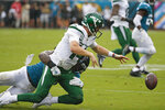 Jacksonville Jaguars defensive end Josh Allen, left, tackles New York Jets quarterback Sam Darnold and forces a fumble during the first half of an NFL football game, Sunday, Oct. 27, 2019, in Jacksonville, Fla. (AP Photo/Stephen B. Morton)