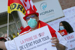 Employees demonstrate to demand higher wages outside a nursing home of the Korian group, one of the market leaders in the lucrative industry of providing care and assisted living facilities for older adults, Monday, May 25, 2020 in Lille, northern France. In France, the group is facing several lawsuits filed by families who have lost loved ones during the coronavirus pandemic that has caused thousands of deaths in French care homes. (AP Photo/Michel Spingler)