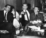 "FILE - Actors left to right, Ben Gazzara, George Segal and Robert Vaughn, stars of film ""The Bridge at Remagen"" relax during press conference at Imperial Hotel in Vienna on Aug. 2, 1968. Segal, the banjo player turned actor who was nominated for an Oscar for 1966's ""Who's Afraid of Virginia Woolf?,"" and starred in the ABC sitcom ""The Goldbergs,"" died Tuesday, his wife said. He was 87.  (AP Photo, File)"