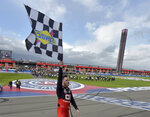 Alex Bowman celebrates with the checkered flag after winning a NASCAR Cup Series auto race Sunday, March 1, 2020 in Fontana, Calif. (AP Photo/Will Lester)